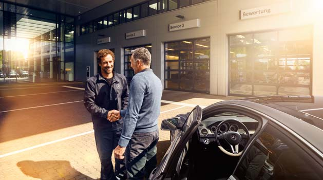Mercedes-Benz team member and customer shaking hands after an MOT.