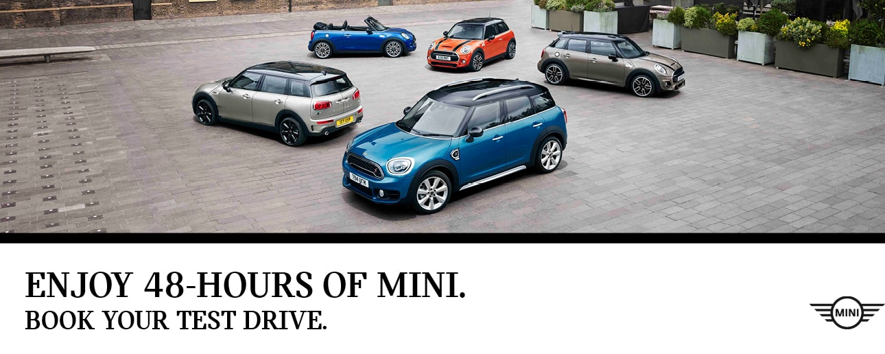 Five MINI's parked outside.