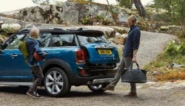 Blue MINI Countryman with the boot open.