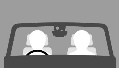 Two people driving