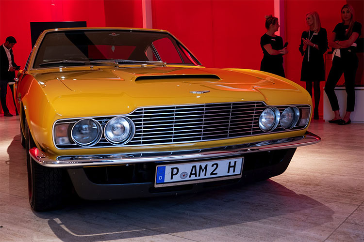 Aston Martin DBS V8 in yellow.