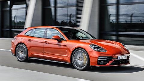 Orange Porsche Panamera Driving