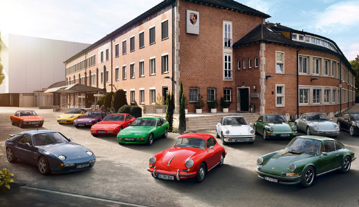Classic Porsche cars parked outside.