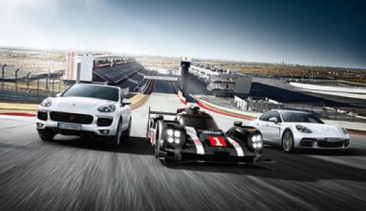 Three Porsche's on the race track.