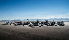 Harley Davidsons lined up outside.
