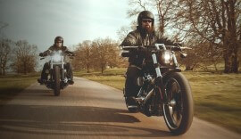 Two Harley Davidsons on the road.
