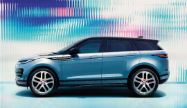 Side view of the blue Range Rover Evoque.