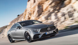 Grey Mercedes-Benz CLS 2018 driving on the road.