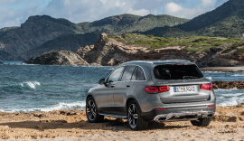 Back view of the new Mercedes-Benz GLC parked by the coast.
