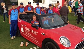 Red MINI supporting celebrity cricketer.