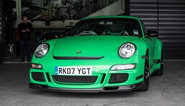 Green Porsche at Cars and Coffee event.