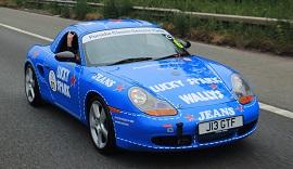 Blue Porsche Classic on the track.