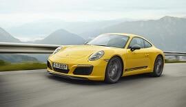Yellow Lightweight Porsche 911 Carrera T on the road.