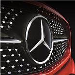Mercedes-Benz badge.
